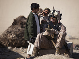 U.S. Marine Practices Pashto with Afghan Boys in Afghanistan Photographic Print by Stocktrek Images