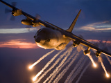 A C-130 Hercules Releases Flares During a Mission Over Kansas Photographic Print by Stocktrek Images