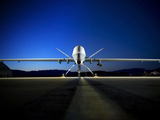 An MQ-9 Reaper Sits On the Flightline Photographic Print by Stocktrek Images