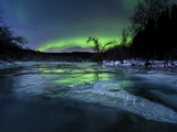 Aurora Borealis Over a Frozen Kvannelva River, Troms, Norway Photographic Print by Stocktrek Images