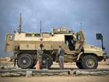 U.S. Army Sergeant Refuels a Caiman MRAP Vehicle, Iraq Photographic Print by Stocktrek Images