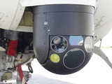 A FLIR Camera Mounted On An EH101 Utility Helicopter Photographic Print by Stocktrek Images