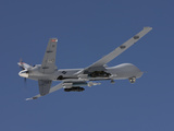 An MQ-9 Reaper Flies a Training Mission Over New Mexico Photographic Print by Stocktrek Images