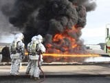 Firefighting Marines Watch As a Training Fire Builds Intensity Photographic Print by Stocktrek Images