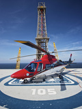 AgustaWestland AW109E Utility Helicopter On the Helipad of An Oil Rig Photographic Print by Stocktrek Images