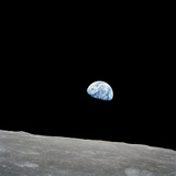 Earth Rising Above the Lunar Horizon Photographic Print by Stocktrek Images