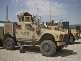 An Oshkosh M-ATV Parked at a Military Base in Afghanistan Photographic Print by Stocktrek Images