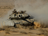 An Israel Defense Force Magach 7 Main Battle Tank in the Negev Desert Photographic Print by Stocktrek Images