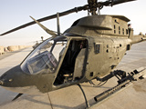 An OH-58D Kiowa Helicopter On the Tarmac at COB Speicher, Iraq Photographic Print by Stocktrek Images