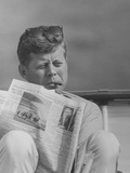 President John F. Kennedy Smoking a Cigar And Reading the Newspaper Photographic Print by Stocktrek Images