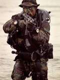 A Navy SEAL Exits the Water Armed And Alert For Action Photographic Print by Stocktrek Images