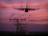 A C-130J Super Hercules Landing at Ramstein Air Base, Germany Photographic Print by Stocktrek Images
