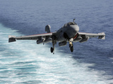 An EA-6B Prowler Lands Aboard the Aircraft Carrier USS John C. Stennis Photographic Print by Stocktrek Images