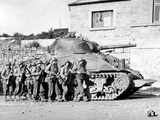 Soldiers And Their Tank Advance Into a Belgian Town During WWII Photographic Print by Stocktrek Images