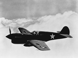 Vintage World War II Photo of a P-40 Fighter Plane Photographic Print by Stocktrek Images