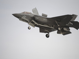 An F-35B Lightning II Joint Strike Fighter Prepares To Make a Vertical Landing Photographic Print by Stocktrek Images