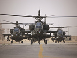 A Group of AH-64D Apache Helicopters On the Runway at COB Speicher Photographic Print by Stocktrek Images