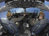 C-17 Globemaster III Pilots Practice Low-level Flying Photographic Print by Stocktrek Images