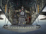 U.S. Navy SEALs Combat Diver Prepares For HALO Jump Operations from a C-130 Hercules Photographic Print by Stocktrek Images