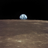 Earth Rising Above the Moon's Horizon Photographic Print by Stocktrek Images