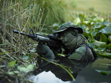 U.S. Navy SEAL Crosses Through a Stream During Combat Operations Photographic Print by Stocktrek Images