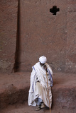 Devotee Outside Bet Medhane Alem Church in Lalibela Photographic Print