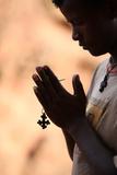 Young Man Praying in Lalibela Photographic Print