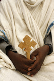 Priest Holding a Cross Photographic Print