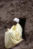 Faithful Reading Outside a Church in Lalibela Photographic Print