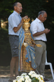 Statue and Worshipers Photographic Print