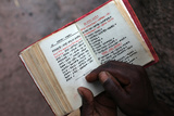 Faithful Reading Outside Bieta Ghiorghis (Saint George's House) Church in Lalibela Photographic Print