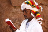 Faithful Reading Outside a Church in Lalibela Photographic Print