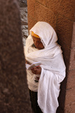 Woman Reading Scriptures Outside Bet Medhane Alem Church in Lalibela Photographic Print