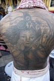 Krishna Tatoo on Devotee's Back Photographic Print
