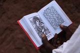 Faithful Reading Scriptures Outside a Lalibela Church Photographic Print