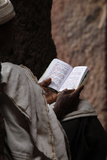 Man Reading Scriptures Outside Bet Medhane Alem Church in Lalibela Photographic Print