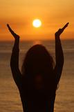 Woman Praying at Sunset Photographic Print