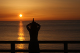 Woman Praying at Sunset Photographic Print