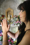 Woman Praying in a Chapel Photographic Print
