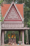 Buddhist Worshipper Praying in a Temple Photographic Print