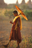 Burmese Novice Buddhist Monk with an Umbrella Photographic Print