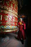 Woman and Prayer Wheel, Baudhnath Stupa Photographic Print