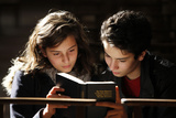 Teenagers Reading a Bible in Saint Philibert's Cathedral Photographic Print