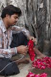Man Making Garlands in a Krishna Temple in New Delhi Photographic Print