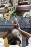 Hindu Devotee Praying in a Tamil Temple Photographic Print