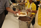 Volunteers Serving Meals, Janmashtami Festival at Bhaktivedanta Manor ISKCON (Hare Krishna) Temple Photographic Print