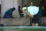 Wash before Prayer, Kapitan Kling Mosque Photographic Print