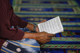 Mulsim Man Reading the Quran in Mosque Photographic Print