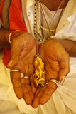 Sadhvi (Female Sadhu) Showing a Ganesh Pendant at the Kumbh Mela in Haridwar Photographic Print