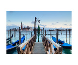 Venice At Sunset With Wooden Pier In The Foregroun Photographic Print by Francesco Carovillano
